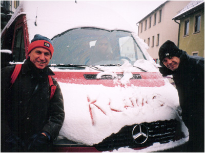 Mark with Rick Lloyd accessing snow on the tour bus